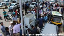 August 3, 2019: Srinagar, Kashmir. 03 August 2019. Queues occur at a petrol pump in Srinagar following a government order calling for tourists as well as Hindu pilgrims to cut short their journey and leave Kashmir because of security concerns.The issuing of the order triggered panic among the residents, who began stockpiling fuel and other essential supplies.Tensions have increased in Indian administered Kashmir following the announcement of the deployment of 10,000 additional troops in the region PUBLICATIONxINxGERxSUIxAUTxONLY - ZUMAd99_ 20190803_zap_d99_003 Copyright: xMuzamilxMattoox