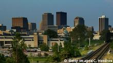 DAYTON, OH - MAY 12: An old smokestack stands with skycrapers on the skyline May 12, 2004 in Dayton, Ohio. Ohio's economic woes have continued during the Bush presidency; since January 2001 the state has lost 265,000 jobs, 162,000 of them in manufacturing. Ohio's economic woes are key to making the state a critical state in the 2004 presidential race. (Photo by Chris Hondros/Getty Images)