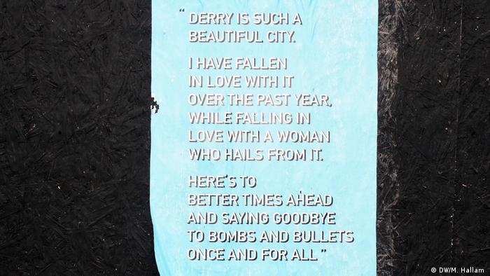 A poster near the central train station in Derry, Londonderry carries a quote from murdered investigative journalist Lyra McKee, killed in the city on April 18, 2019. (DW/M. Hallam )