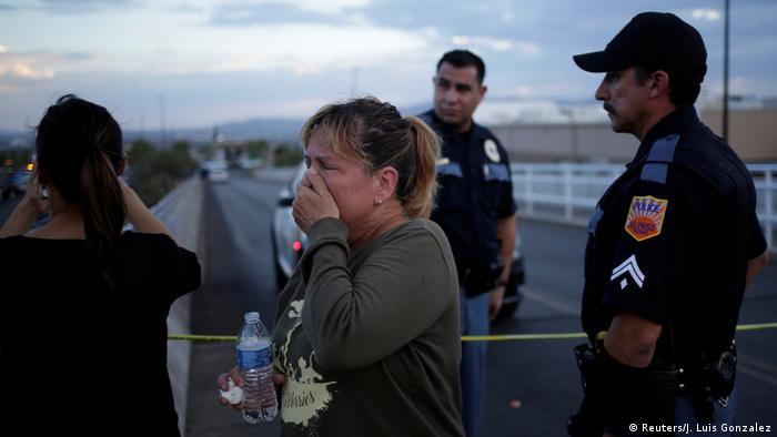 A woman reacts after a mass shooting at a Walmart in El Paso, Texas