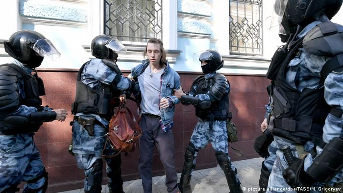 Russian police arrest a protester
