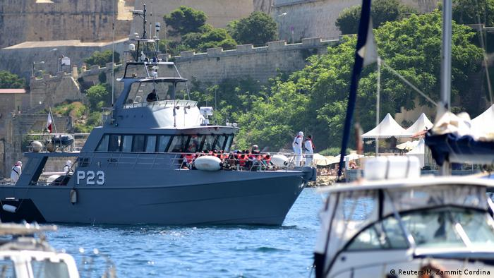 Patrol boats carrying migrants rescued by the Alan Kurdi vessel enter the Maltese harbor