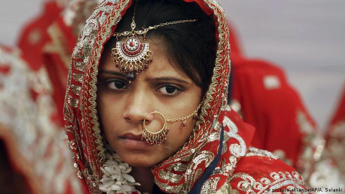 An Indian Muslim bride watches during a mass marriage in Ahmadabad, India