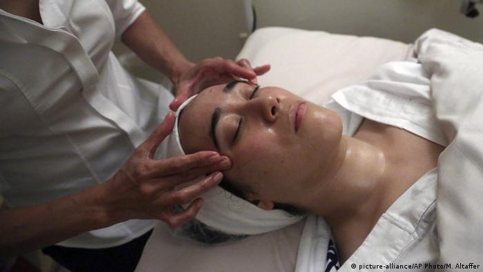 Woman getting a facial
