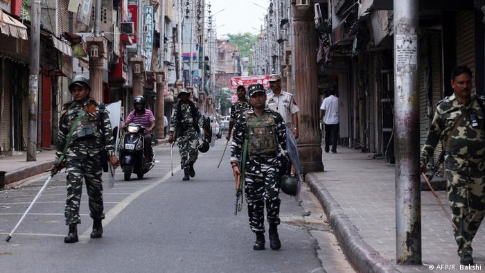 Security personnel patrol the streets of Jammu, Kashmir