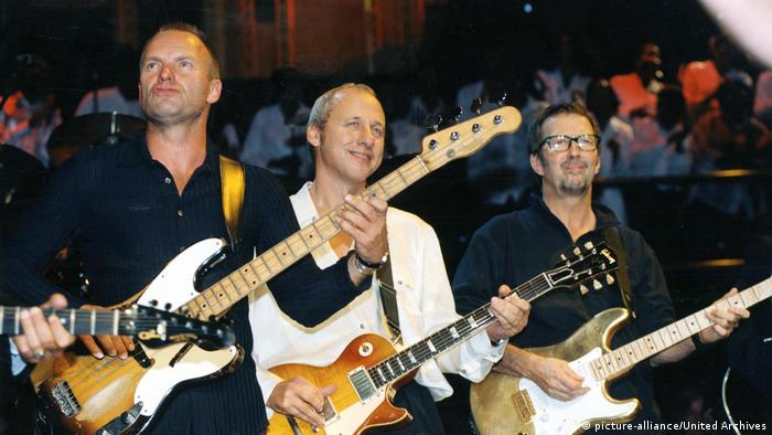 Charity concert in 1997 Sting, Mark Knopfler and Eric Clapton (picture-alliance/United Archives)