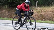 German Fiona Kolbinger crosses the finish line and win the Transcontinental Race, a 4000 km self-supported cycling race across Europe, in Brest, western France, on August 6, 2019. (Photo by Fred TANNEAU / AFP) . (Photo credit should read FRED TANNEAU/AFP/Getty Images)