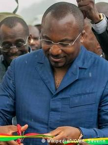 Denis Christel Sassou-Nguesso smiles as he cuts a ribbon during a public event