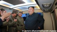 N. Korea fires 'new-type tactical guided missiles North Korean leader Kim Jong-un (R) smiles as he watches the firing of new-type tactical guided missiles on Aug. 6, 2019, in this photo released by the North's official Korean Central News Agency (KCNA) on Aug. 7, 2019. Kim said this week's missile launches were an adequate warning against the joint military exercise between South Korea and the United States that kicked off earlier this week, the KCNA said. (For Use Only in the Republic of Korea. No Redistribution) (Yonhap)/2019-08-07 08:57:26/ | Keine Weitergabe an Wiederverkäufer.
