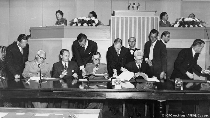 Signing of the revised and expanded texts of the first three Geneva Conventions on August 12, 1949 (ICRC Archives (ARR)/J. Cadoux)