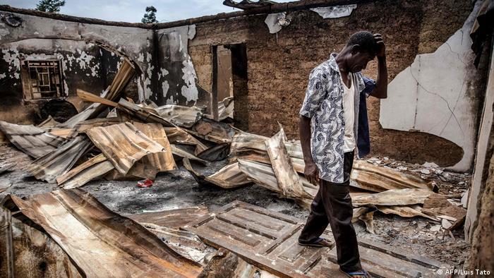 A farmer checking his burned down house
