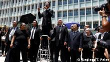 Lawyers and workers in Hong Kong's legal sector gather outside the Department of Justice during a protest in Hong Kong, China August 7, 2019. REUTERS/Thomas Peter