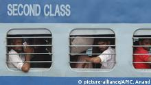 Indian migrant laborers sit inside a train as they prepare to leave the region, at a railway station in Jammu, India, Wednesday, Aug. 7, 2019. Indian lawmakers passed a bill Tuesday that strips statehood from the Indian-administered portion of Muslim-majority Kashmir, which remains under an indefinite security lockdown, actions that archrival Pakistan warned could lead to war. (AP Photo/Channi Anand) |