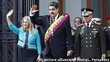 Venezuela's President Nicolas Maduro, center, and first lady Cilia Flores, wave to supporters as they leave the National Pantheon after attending a ceremony to commemorate an 1800's independence battle, in Caracas, Venezuela, Wednesday, Aug. 7, 2019. Sweeping new U.S. sanctions freeze all of the Maduro government's assets in the U.S. and even threaten to punish companies from third countries that keep doing business with his socialist administration. The first couple is accompanied by Defense Minister Gen. Padrino Lopez. (AP Photo/Leonardo Fernandez) |