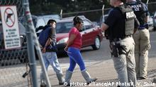 Two people are taken into custody at a Koch Foods Inc. plant in Morton, Miss., on Wednesday, Aug. 7, 2019. U.S. immigration officials raided several Mississippi food processing plants on Wednesday and signaled that the early-morning strikes were part of a large-scale operation targeting owners as well as employees. (AP Photo/Rogelio V. Solis) |