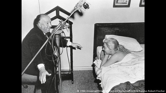 Alfred Hitchcock and Kim Novak on the set of Vertigo (1958 Universal/TASCHEN/Herbert Klemens/Filmbild Fundus Robert Fischer)