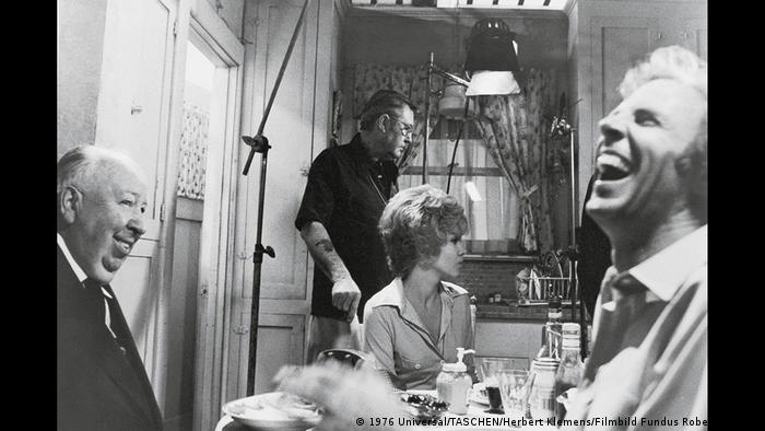 On the set of Family Plot Hitchcock laughing with crew (1976 Universal/TASCHEN/Herbert Klemens/Filmbild Fundus Robert Fischer)