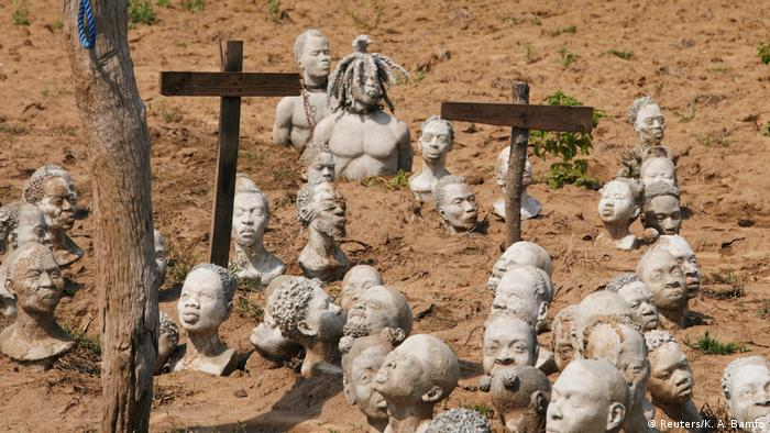 An installation by Ghanaian artist Kwame Akoto Bamfo shows ancestors sold into slavery. The clay figures are stuck in mud up to their breast or their chin.