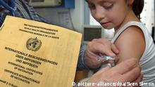 a certificate of vaccination and a child receiving injection into its arm