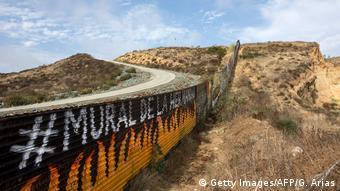 Partial view of the US-Mexico border wall painted by members of the Brotherhood Mural organization in Tijuana, Mexico