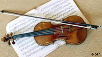 A violin lies on top of sheet music