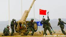 Chinese soldiers of People's Liberation Army (PLA) participate in a contest next to a howitzer during the International Army Games 2019 in Korla, Xinjiang Uighur Autonomous Region, China August 5 2019. Picture taken August 5, 2019. Wang Xiaojun/CNS via REUTERS ATTENTION EDITORS - THIS IMAGE WAS PROVIDED BY A THIRD PARTY. CHINA OUT.
