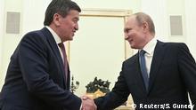 Russland Sooronbai Dscheenbekow und Wladimir Putin