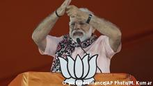 FILE - In this April 1, 2019, file photo, Indian Prime Minister Narendra Modi gestures as he speaks during an election campaign rally of his Bharatiya Janata Party (BJP) in Hyderabad, India. Modi's vision of a Hindu India took a leap forward with his government's decision in August to subsume Kashmir into the federal government by eliminating its special status and allowing anyone to buy property and move into the state, raising fears among residents that they will lose their distinct identity. Modi's home minister, Amit Shah, considered the architect of the Hindu nationalist-led government's aggressive agenda to convert India from a secular, multicultural democracy into a distinctly Hindu, culturally and politically homogenous state, sold the new policy on Kashmir to parliament by equating it with Pakistan, India's staunch foe. (AP Photo/Mahesh Kumar A., File) |