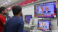 08.08.2019 *** Indians watch Prime Minister Narendra Modi address the nation in a televised speech, in an electronics store in Jammu, India, Thursday, Aug. 8, 2019. Modi says a federally-ruled Indian portion of Kashmir will help end decades-old separatism incited by archrival Pakistan. Describing changes in Kashmir as historic, Modi assures Kashmiri people that the situation in the region will soon become normal. (AP Photo/Channi Anand)