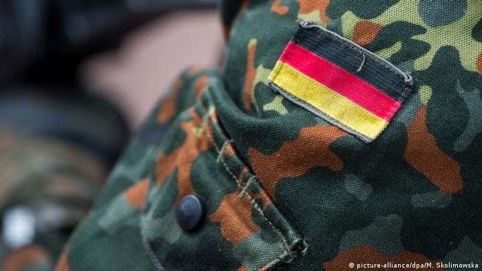 A flag patch on the shoulder of a German soldier