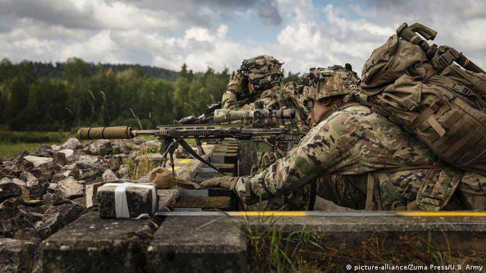 Soldiers in camouflage practice sniper training at Grafenwöhr training area in Bavaria, part of a US army post
