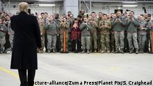 President Donald Trump addresses U.S. service members during stop-over at Ramstein Air Force Base
