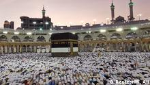 Muslims pray toward the Kaaba during the hajj