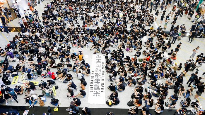 Anti-extradition bill demonstrators attend a protest at the arrivals hall of Hong Kong Airport, China, on August 9, 2019.
