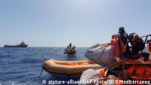 In this photo taken on Wednesday Aug. 7, and made available on Thursday, Aug. 9, 2019, the crew of the Ocean Viking rescue ship run by the SOS Mediterranee NGO takes part in a drill, as the ship navigates in the Mediterranean Sea, after leaving the Marseille harbor on Aug. 5 to start its humanitarian mission. (Photo SOS Mediterranee via AP) |