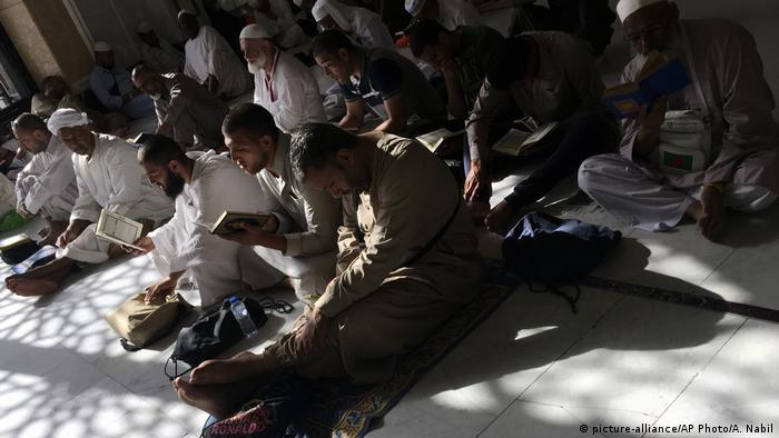Men pray ahead of the hajj in Saudi Arabia