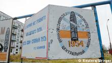 A view shows a board on a street of the military garrison located near the village of Nyonoksa in Arkhangelsk Region, Russia October 7, 2018. The board reads: State Central Naval Range. Picture taken October 7, 2018. REUTERS/Sergei Yakovlev