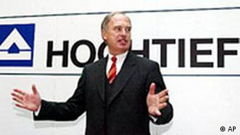 Chairman of the board of directors of German construction company Hochtief, Hans-Peter Keitel is gesturing prior to the annual balance press conference held in Essen, western Germany on Wednesday April 17, 2002.