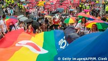 August 10, 2019*** People hold placards and rainbow flags during the 9th gay pride event in the Czech capital Prague on August 10, 2019. - About 30,000 people took part in the Prague Pride Parade of the LGBT community while a similar march in neighbouring Poland went smoothly despite concerns. (Photo by Michal CIZEK / AFP) (Photo credit should read MICHAL CIZEK/AFP/Getty Images)