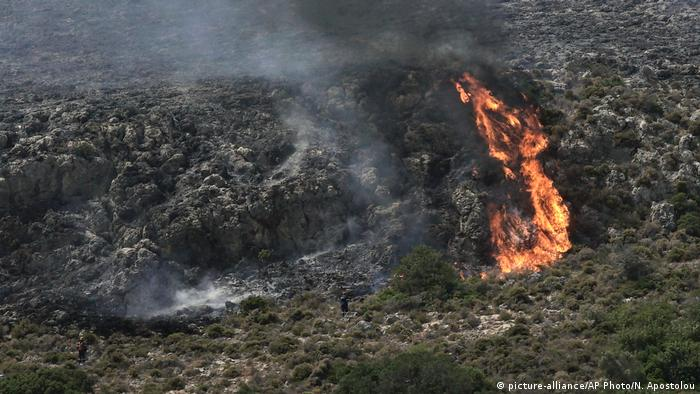 An island burns in Greece