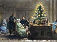 Gemälde mit der Familie Martin Luthers neben einem Weihnachtsbaum (Foto: Ullstein-Bild)