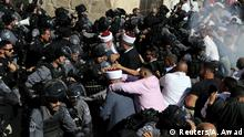 Israeli police clash with Palestinian worshippers on the compound known to Muslims as Noble Sanctuary and to Jews as Temple Mount as Muslims mark Eid al-Adha, in Jerusalem's Old City August 11, 2019. REUTERS/Ammar Awad