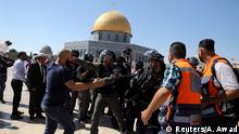 The Dome of the Rock is seen in the background as Israeli police clash with Palestinian worshippers on the compound known to Muslims as Noble Sanctuary and to Jews as Temple Mount as Muslims mark Eid al-Adha, in Jerusalem's Old City August 11, 2019. REUTERS/Ammar Awad