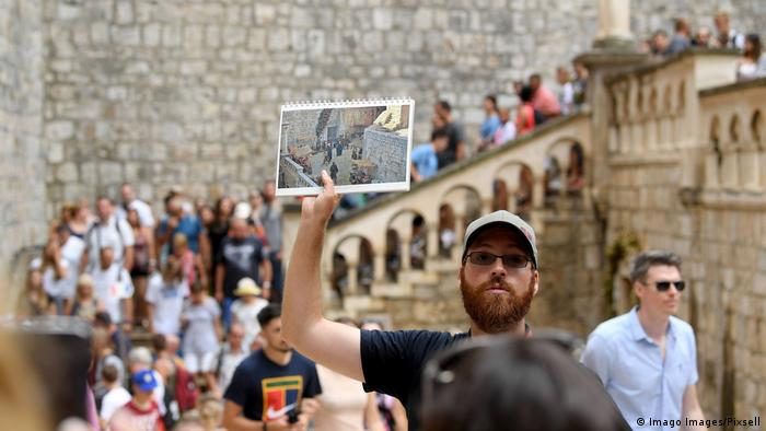 Groups of people take part in a Game of Thrones tour through Dubrovnik, Croatia