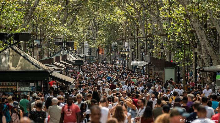 Barcelona's Ramblas pedestrian boulevard packed with people milling around