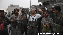 In this Friday Aug. 9, 2019 frame grab from video, Southern Transitional Council separatist fighters line up before storming the presidential palace in the southern port city of Aden, Yemen. The separatists backed by the United Arab Emirates began withdrawing Sunday from positions they seized from the internationally-recognized government in Aden . Both the southern separatists and the government forces are ostensibly allies in the Saudi-led military coalition that's been battling the Houthi rebels in northern Yemen since 2015, but the four days of fighting in Aden have exposed a major rift in the alliance. (AP Photo)