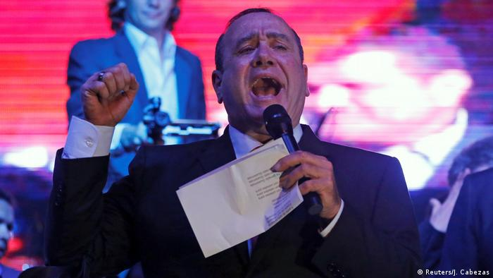 Guatemalan President-elect Alejandro Giammattei yells to his supporters during a victory rally