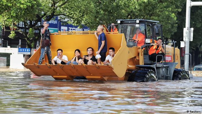 A bulldozer evacuating residents in China after typhoon Lekima