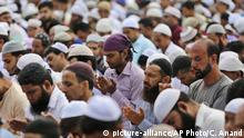 Muslim men offer prayers during Eid al-Adha, or the Feast of the Sacrifice, in Jammu, India, Monday, Aug.12, 2019. An uneasy calm prevailed in Indian-administered Kashmir on Monday as people celebrated a major Islamic festival during a severe crackdown after India moved to strip the disputed region of its constitutional autonomy and imposed an indefinite curfew. (AP Photo/Channi Anand) |