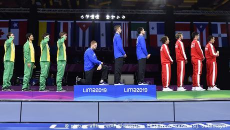 Race Imboden kneels during medal presentation